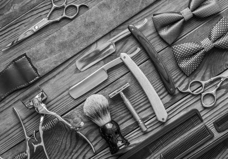 vintage-barber-shop-tools-on-wooden-background-PZJCPNV
