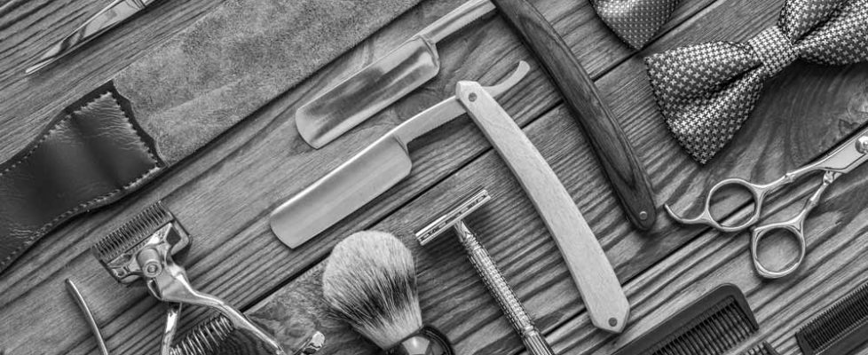 vintage-barber-shop-tools-on-wooden-background-PZJCPNV
